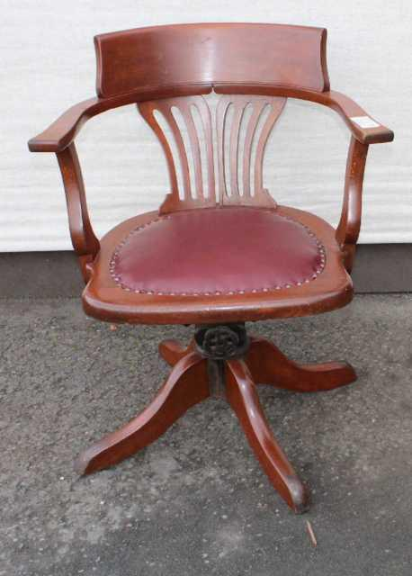 1920's Leather Oak Office Chair. Leather Seat Carved Back. On Castors