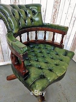 An Antique Style Green Leather Button Captains Chair Delivery Available
