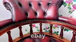 Captains Chair. Beautiful Oxblood leather Chesterfield Style swivel/office/chair