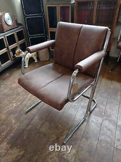 Mid century office chairs X 2. Chrome. Tan. Brown. Faux leather. Vintage