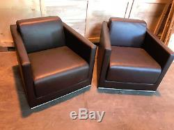 Pair of Leather style single seater reception/waiting chairs