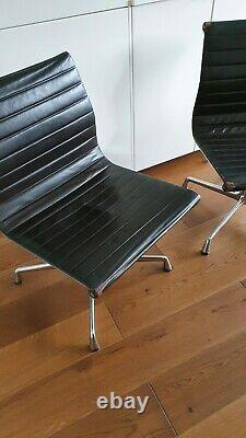 Pair of vintage Vitra Eames chairs in dark brown leather home office / study