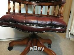 Vintage red leather chesterfield captains chair
